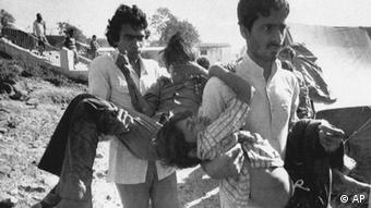 In this Decembe 5, 1984 file photo, two men carry children blinded by the Union Carbide chemical pesticide leak to a hospital in Bhopal, India. Photo: AP Photo/Sondeep Shankar, File
