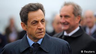 Nicolas Sarkozy (left)