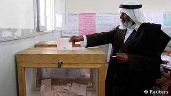 An Egyptian bedouin casts his vote in a school used as a voting center in El-Sheikh Zouied city, north Sinai January 3, 2012. REUTERS/Asmaa Waguih