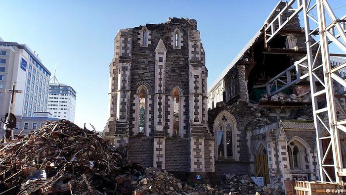 In this photo taken Friday, July 8, 2011, a cathedral in a square is badly damaged in downtown Christchurch, New Zealand