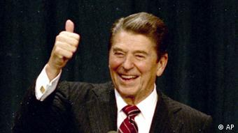 ** FILE ** President Ronald Reagan gives a thumbs-up to supporters at the Century Plaza Hotel in Los Angeles as he celebrates his re-election, Nov. 6, 1984, with first lady Nancy Reagan at his side. Reagan's win over Walter Mondale, 525 to 13 in the electoral vote and 59 percent to 41 percent in popular votes, was unquestionably a landslide election. (AP Photo/File)