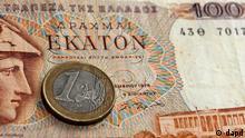 EU Griechenland Finanzkrise Euro-Krise 1 Euro Münze und 100 Drachmen Geldschein