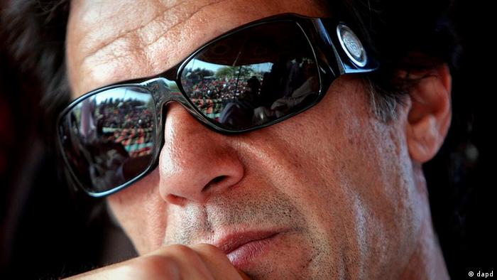 Pakistani cricketer-turned-politician Imran Khan listens to the speech of a politician during a rally against the U.S. drone strikes in Pakistani tribal areas, Sunday, April 24, 2011, in Peshawar, Pakistan (Photo: ddp images/AP Photo/Mohammad Sajjad)