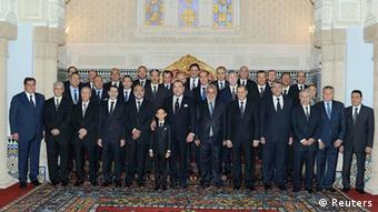 Morocco's King Mohammed (front C) and Crown Prince Moulay Hassan pose for a family picture with members of the new cabinet, led by leader of the Islamist Justice and Development Party (PJD) Abdelilah Benkirane, at the royal palace in Rabat January 3, 2012. King Mohammed awarded the foreign and justice ministries on Tuesday to the moderate Islamist party that won a November election but reserved the domestic security portfolio for a veteran conservative close to the monarch. REUTERS/Maghreb arabe presse/Handout (MOROCCO - Tags: POLITICS ROYALS) FOR EDITORIAL USE ONLY. NOT FOR SALE FOR MARKETING OR ADVERTISING CAMPAIGNS. THIS IMAGE HAS BEEN SUPPLIED BY A THIRD PARTY. IT IS DISTRIBUTED, EXACTLY AS RECEIVED BY REUTERS, AS A SERVICE TO CLIENTS