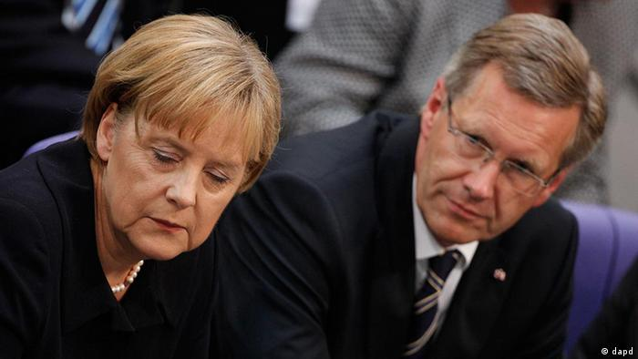 Merkel sitting with her eyes closed next to Wulff as the Federal Convention meets