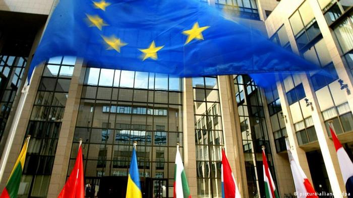 EU member flags in front of the bloc's headquarters in Brussels