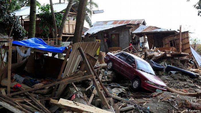 Typhoon Washi survivors rest in a makeshift shelter