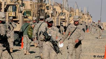 U.S. Army soldiers from the 1st Cavalry Division, the last soldiers to leave Iraq, arrive at Camp Virginia, Kuwait, Sunday, Dec. 18, 2011.