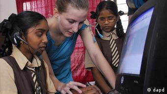 A voluntary social worker Immy Bidwell from Scotland helps a visually challenged student Saraswathi on computer at Devnar School for Blind in Hyderabad, India, Wednesday, Aug. 1, 2007. The first digital library for visually challenged students in Andhra Pradesh was inaugurated in the school. (ddp images/AP Photo/Mahesh Kumar A.)