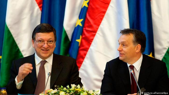 File photo: In 2011, European Commission President Jose Manuel Barroso (L) and Hungarian Prime Minister Viktor Orban (R) smile during a joint session of the Hungarian government and the European Commission in the Parliament building in Budapest, Hungary, on January 7, 2011. (Photo via dpa)