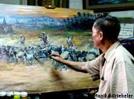 U Maung Maung Thein paints a landscape in his atelier