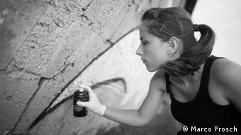 Graffiti artist Claudia Walde spray paints