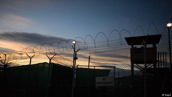 File - In this file image reviewed by the U.S. Military, the sun rises over Guantanamo detention facility, at the U.S. Naval Base, in Guantanamo Bay, Cuba, Nov. 19, 2008. The White House acknowledged for the first time Friday Sept. 25, 2009 that it might not be able to close the U.S. military prison at Guantanamo Bay by January as President Barack Obama has promised. Senior administration officials told The Associated Press that difficulties in completing the lengthy review of detainee files and resolving thorny legal and logistical questions mean the president's self-imposed January deadline may slip. (ddp images/AP Photo/Brennan Linsley, File)