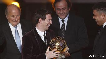 Lionel Messi of Argentina (2L), FIFA World Player of the Year holds his FIFA Ballon d'Or 2011 trophy next to FIFA President Sepp Blatter (L), UEFA President Michel Platini (2R) and Ronaldo (R) during the FIFA Ballon d'Or 2011 soccer awards ceremony at the Kongresshaus in Zurich January 9, 2012. (Photo via Reuters)