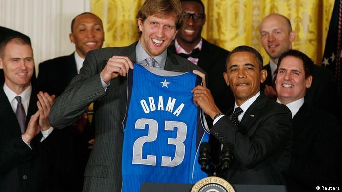 Dirk Nowitzki holds up an Obama Mavericks jersey