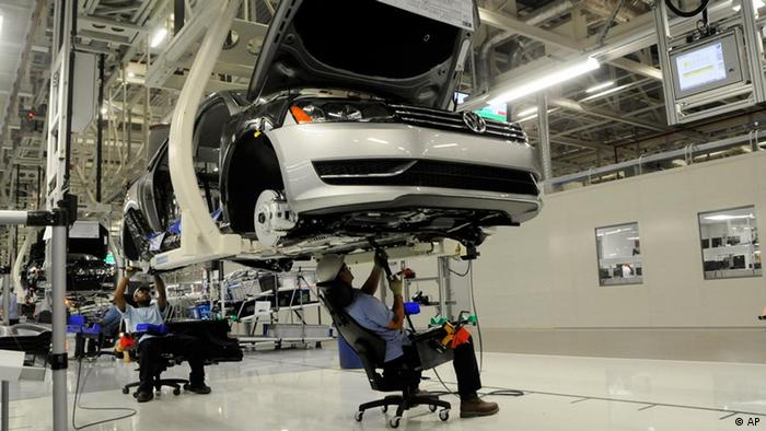 Workers inspect the undercarriage of a new Passat inside the new Volkswagen plant in Chattanooga AP Photo/Billy Weeks