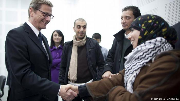 epa03054551 German Foreign Minister Guido Westerwelle (L) talks to Tunisian bloggers in Tunis, Tunisia, 09 January 2012. Westerwelle praised Tunisia as a model for North Africa at talks with the country's new President Moncef Marzouki, on the last day of his three-day North Africa tour. Westerwelle also said he was encouraged by Tunisia's progress in making the transition from dictatorship to democracy. Germany has pledged 32 million euros towards the establishment of democratic institutions in Tunisia over the next two years. EPA/THOMAS TRUTSCHEL/POOL