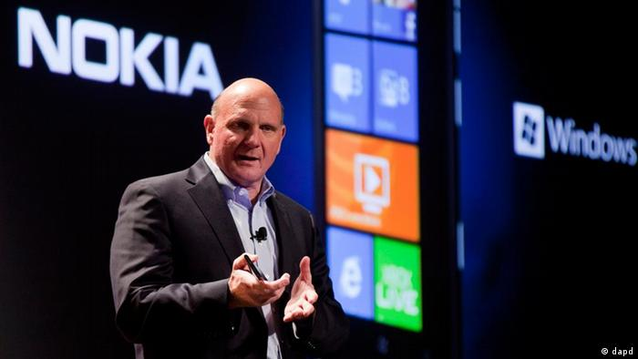 Microsoft CEO Steve Ballmer talks about the new Nokia Lumia 900 smartphone during a CES news conference, Monday, Jan. 9, 2012, in Las Vegas. The 2012 International CES tradeshow, the world's largest consumer electronics exhibition, starts Tuesday. (AP Photo/Julie Jacobson)