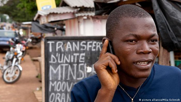 A man using a mobile phone in an African country