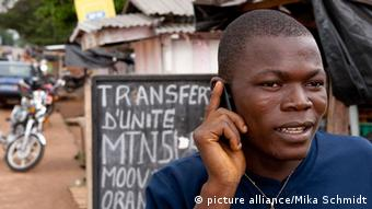 A man in Africa talks on a cell phone