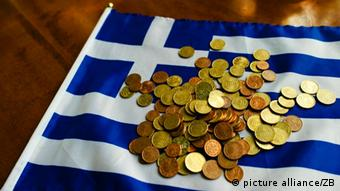 A Greek flag with money on it.