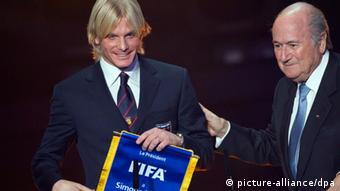 Farina receives an award from FIFA boss Sepp Blatter