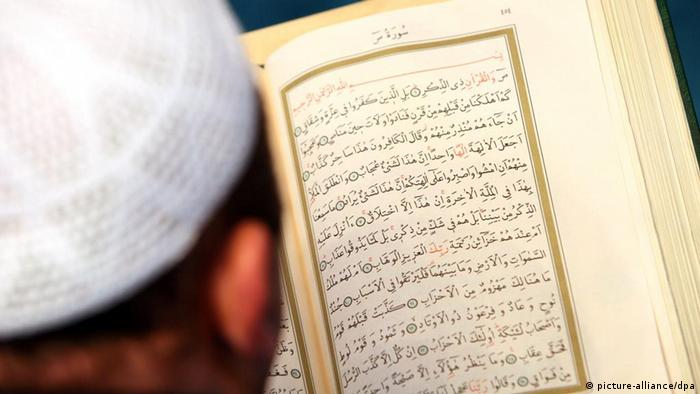 An Imam in a Berlin mosque reads a copy of the Koran