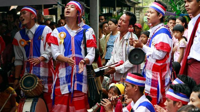 Clad in traditional dress, ethnic Karen traditional dancing troupe enjoy themselves during the cerebration of Karen's New Year at a monastery on Sunday, Dec. 25, 2011, in Yangon, Myanmar. (AP Photo/Khin Maung Win)