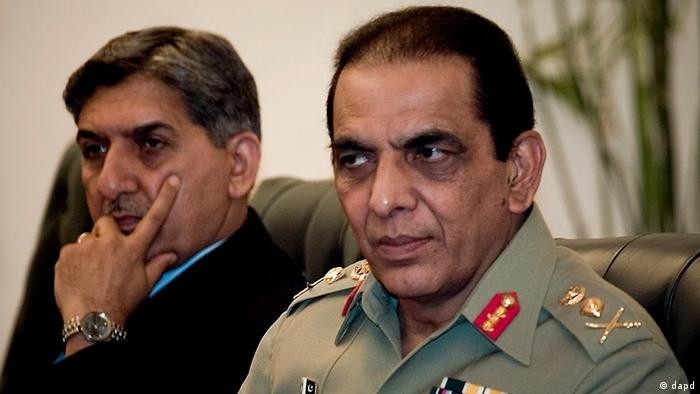Pakistan's army chief Gen. Ashfaq Parvez Kayani, right, and former military's spy agency's chief Lt. Gen. Ahmed Shuja Pasha attend a meeting in Islamabad, Pakistan. Pakistan's powerful army chief said in a rare briefing to parliamentarians in 2011