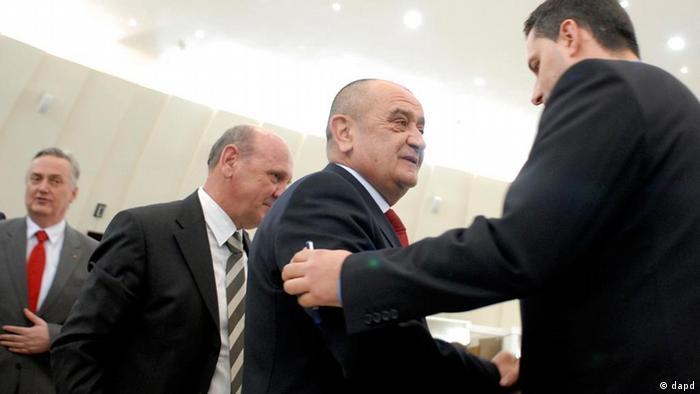 Vjekoslav Bevanda shakes hand of lawmaker