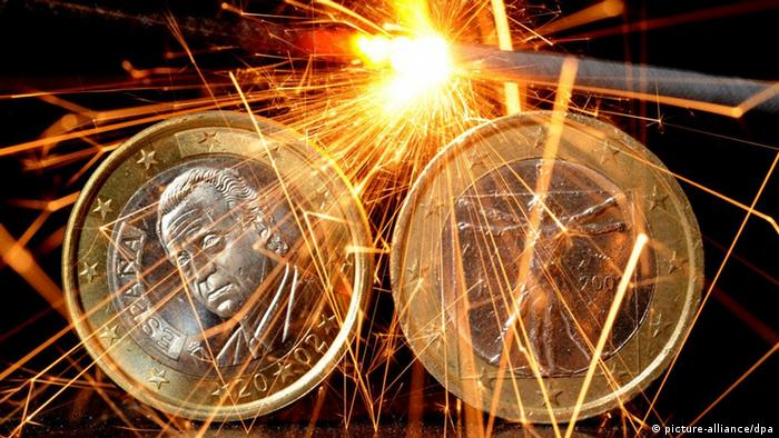 Sparks surrounding Italian and Spanish euro coins