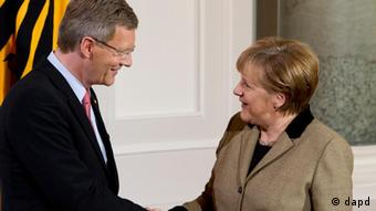 Wulff and Merkel shaking hands
