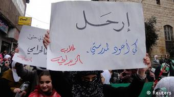 Demonstrators protest against Syria's President Bashar al-Assad in Zabadani, near Damascus Januray 13, 2012. The banner reads, Go, want to back to my school. REUTERS/Handout (SYRIA - Tags: POLITICS CIVIL UNREST) FOR EDITORIAL USE ONLY. NOT FOR SALE FOR MARKETING OR ADVERTISING CAMPAIGNS. THIS IMAGE HAS BEEN SUPPLIED BY A THIRD PARTY. IT IS DISTRIBUTED, EXACTLY AS RECEIVED BY REUTERS, AS A SERVICE TO CLIENTS