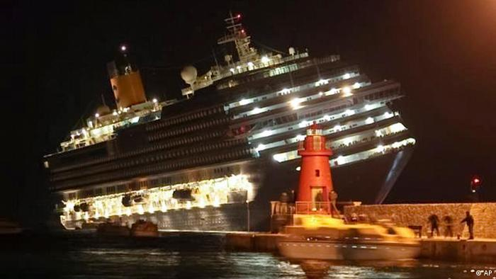 The luxury cruise ship Costa Concordia leans after it ran aground off the coast of Isola del Giglio island, Italy,