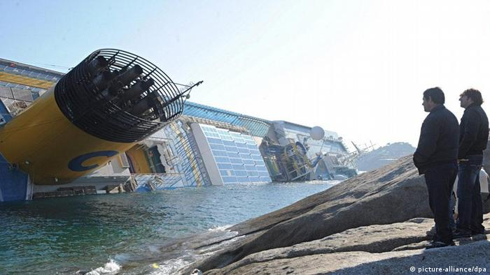 epa03059552 The Costa Concordia cruise ship is pictured listing just off the island of Giglio, northern Italy, early 14 January 2012, after she ran ground in the early hours of the morning. At least 50 people were believed to be missing after the cruise ship ran aground off Italy's western coast and began to sink, media reported 14 January. The Costa Concordia liner had set off on 13 January from the port of Civitavecchia, near Rome, for the start of a Mediterranean cruise, when its crew signalled an electrical fault to port authorities. EPA/MAURIZIO DEGL'INNOCENTI