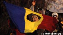 epa03059814 Young Romanian protesters shouts anti-government and anti-presidential slogans while waving the 1989 Revolution flag during a violent protest supporting under secretary of state in Romania's Health Ministry, Raed Arafat, at University Plaza, central Bucharest, 14 January 2012. Hundreds of people gathered to support Raed Arafat, the founder of Romanian emergency service (SMURD) who resigned from his position at the health ministry on 11 January, to protest against the proposed reform aimed at opening the vital sector to private operators, which was designed without the consensus of medical associations and civil society. Romania's President Traian Basescu called on the prime minister to withdraw the controversial health reform law package. Two riot policemen and a TV journalist were injured during the clashes between riot policemen and protesters. EPA/ROBERT GHEMENT +++(c) dpa - Bildfunk+++