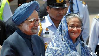 Bangladesh Prime Minister Sheikh Hasina, right, escorts Indian Prime Minister Manmohan Singh left, after receiving him at the airport in Dhaka, Bangladesh, Tuesday, Sept. 6, 2011