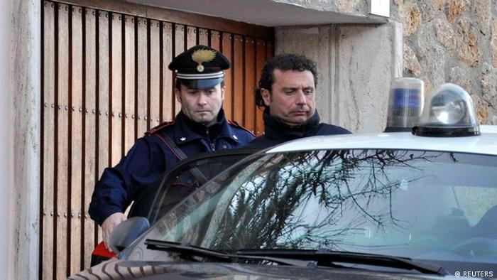 Costa Concordia cruise liner captain Francesco Schettino (R) is escorted by a Carabinieri in Grosseto January 14, 2012 (Reuters)