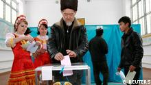 A man casts his vote at a polling station during parliamentary elections in the village of Karasuu, some 240 km (149 miles) southwest of Almaty, southern Kazakhstan January 15, 2012. Kazakhstan voted on Sunday in an election designed to put a second party in parliament and ease growing discontent after deadly riots shook the country's image of stability. REUTERS/Vladimir Pirogov (KAZAKHSTAN - Tags: POLITICS ELECTIONS)