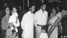 India's Prime Minister Indira Gandhi, far right, stands with her family in New Delhi, Sept. 17, 1973. From left, Mrs Gandhi's daughter-in-law Sonia carrying grandaughter Priyanki; sons Sanjay and Rajiv; and grandson Rahul. (AP Photo)