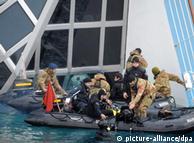 rescuers examining the ship