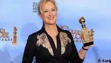 Actress Meryl Streep poses with her award for best performance by an actress in a motion picture - drama for The Iron Lady, backstage at the 69th annual Golden Globe Awards in Beverly Hills, California January 15, 2012. REUTERS/Lucy Nicholson (UNITED STATES - Tags: ENTERTAINMENT PORTRAIT) (GOLDENGLOBES-BACKSTAGE)