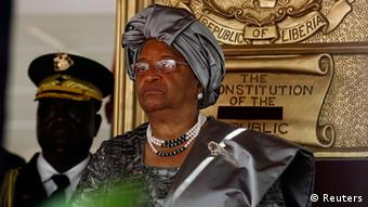 Liberian President Ellen Johnson-Sirleaf stands at a ceremony to mark her second presidential inauguration at the Capitol in Monrovia January 16, 2012. (REUTERS/Larry Downing)