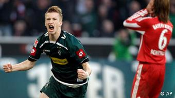 Moenchengladbach's Marco Reus, left, celebrates after scoring while Bayern's Martin Demichelis of Argentina reacts during the German first division Bundesliga soccer match between VfL Borussia Moenchengladbach and Bayern Munich in Moenchengladbach, Germany, Saturday, Nov. 6, 2010. (AP Photo/Frank Augstein) ** NO MOBILE USE UNTIL 2 HOURS AFTER THE MATCH, WEBSITE USERS ARE OBLIGED TO COMPLY WITH DFL-RESTRICTIONS, SEE INSTRUCTIONS FOR DETAILS **