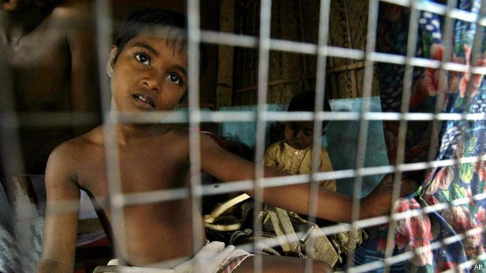 P. Sunjada, 6, a Tamil war refugee boy, look through the window at a temporary shelter in a refugee camp in Jaffna, 300 kilometers (188 miles) north of Colombo, Sri Lanka, (ddp images/AP Photo/Rafiq Maqbool)