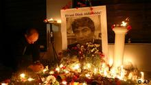 A Turkish man lights candles in front of a picture of the slain journalist Hrant Dink, background, outside of the offices of Armenian newspaper Agos in Istanbul, Turkey, early Saturday, Jan. 20, 2007. Dink, one of the most prominent voices of Turkey's shrinking Armenian community, was killed by a gunman Friday at the entrance to his newspaper's offices. Dink, a 53-year-old Turkish citizen of Armenian descent, had gone on trial numerous times for speaking out about the mass killings of Armenians by Turks at the beginning of the 20th century. Writing in Turkish on picture reads: Hrant Dink killed! (AP Photo)