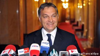 Hungarian Prime Minister Viktor Orban smiles as he briefs the media after he met with President of the Hungarian National Bank, the central bank, Andras Simor (unseen) in his office in the Parliament building in Budapest, Hungary, 06 January 2012. After the meeting Orban said he agreed with Simor on the closest possible cooperation between the government and the central bank to strengthen the confidence in the Hungarian currency forint the rate of which had reached record depth against major international currencies recently due to uncertainties about Hungary's eventual credit agreement with IMF. EPA/TAMAS KOVACS HUNGARY