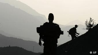 Turkish soldiers patrol in the province of Sirnak, on the Turkish-Iraqi border, southeastern Turkey, Tuesday, Oct. 23, 2007. (AP Photo/Ibrahim Usta)