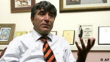 Hrant Dink seated in his office
