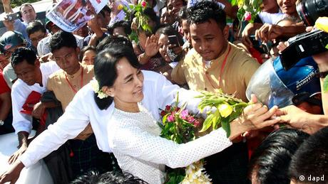 a Aung San Suu Kyi greets a crowd in 2012